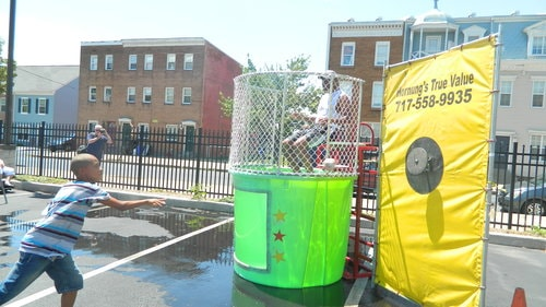 Chief Carter gets dunked at the 2015 Homeland Center Summertime Fair