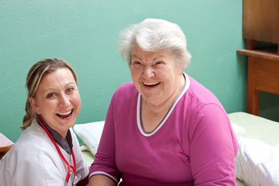 Nurse Smiling with Elderly