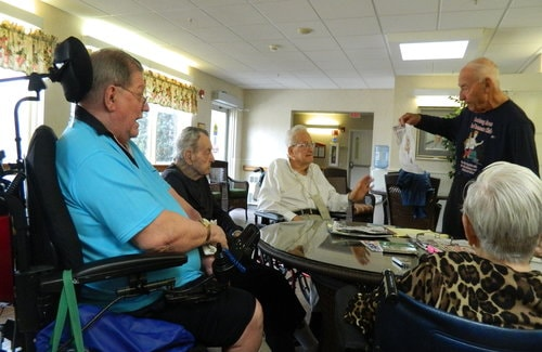 Herm Minkoff talks to, from left, residents Dick Simons, Edwin Kingston, Stanley Fabiano and Verna Tarasi