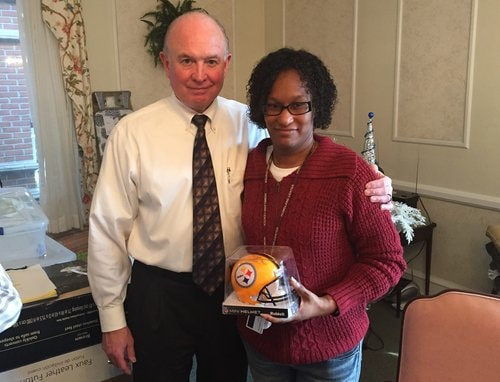 Barry Ramper gives commemorative Steelers helmet to Felicia Foster