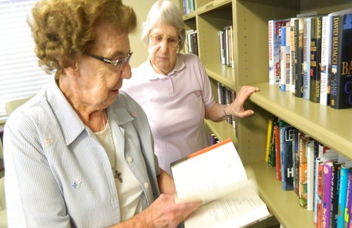 Marie Andrews and Vivian Black sorting books